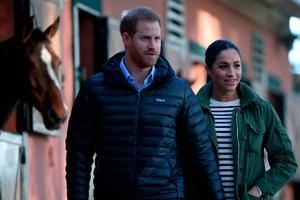 Prince Harry and his wife Meghan, Duke & Duchess of Sussex, arrive at the Moroccan Royal Federation of Equestrian Sports in Rabat on February 25, 2019. (Photo by FADEL SENNA / AFP)