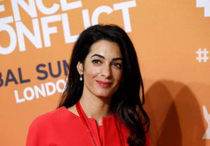 Amal Alamuddin, human rights lawyer and fiancee of US actor George Clooney attends the 'End Sexual Violence in Conflict' summit in London. (AP Photo/Lefteris Pitarakis)