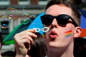 A man blows bubbles as supporters for same-sex marriage wait for the result of the referendum at Dublin Castle on May 23, 2015 in Dublin. Ireland looked set today to become the first country in the world to approve gay marriage by popular vote as crowds cheered in the streets of Dublin in anticipation of the spectacular setback for the once all-powerful Catholic Church. AFP PHOTO /  Paul FaithPAUL FAITH/AFP/Getty Images