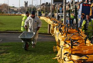 Dublin City Council workers lay sandbags in Clontarf this evening in preparation for this weekend's high tides and winds