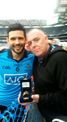 John Garbutt with his father's ashes at Hill 16 Croke Park with Cian O'Sullivan