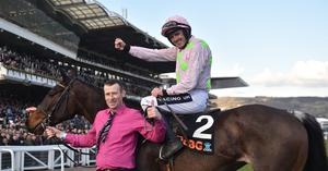 Ruby Walsh with stable hand Brendan Kenny after winning the OLBG Mares Hurdle Race on Benie Des Dieux in 2018