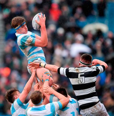 Charlie Ryan of Blackrock College takes possession in a lineout ahead of Oran O'Brien of Belvedere College. Photo: Sportsfile