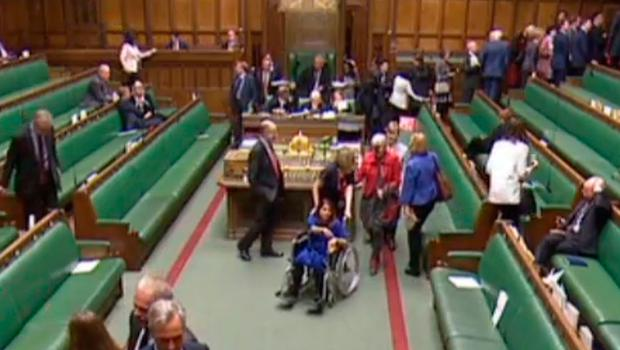 """A video grab from footage broadcast by the UK Parliament's Parliamentary Recording Unit (PRU) shows Labour Party MP Tulip Siddiq (C) being pushed in a wheelchair in the House of Commons in London  (Photo by HO / various sources / AFP) / RESTRICTED TO EDITORIAL USE - MANDATORY CREDIT """" AFP PHOTO / PRU """" - NO USE FOR ENTERTAINMENT, SATIRICAL, MARKETING OR ADVERTISING CAMPAIGNSHO/AFP/Getty Images"""
