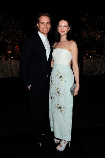 """Actors Sam Heughan (L) and Caitriona Balfe attend the """"Outlander"""" Season 2 Premiere on April 4, 2016 in New York City.  (Photo by Craig Barritt/Getty Images for STARZ)"""