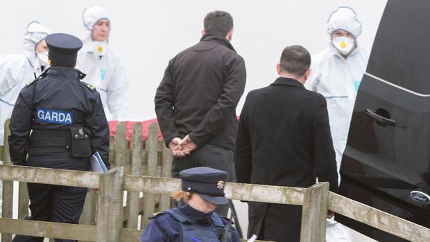 Detectives remove the body to the morgue. Picture: North West Newspix