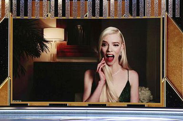 "Anya Taylor-Joy reacts via video after being announced winner of the Best Actress - Television Motion Picture award for ""The Queen's Gambit,"" in this handout photo from the 78th Annual Golden Globe Awards Christopher Polk/NBC Handout via REUTERS"