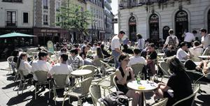 Diners relax at a cafe in Rennes in France. In France, people start paying the marginal rate of tax at €186,749 pa. In the US, the higher rate kicks in at €301,163; in Germany it starts at €259,103; and in Britain, €183,285. Here in Ireland the marginal income tax rate kicks in at €32,800 for a single person