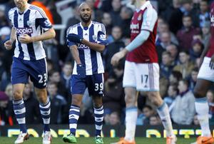 Nicolas Anelka (centre) performing the controversial 'quenelle' gesture