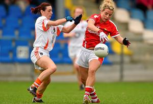 Cork's Valarie Mulcahy looks to grab possession ahead of Mairead Tennyson of Armagh during the All-Ireland ladies football semi-final at Pearse Park. Photo: Paul Mohan / SPORTSFILE