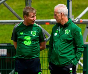 Changing of guard: Mick McCarthy speaking with his successor Stephen Kenny in May last year. Photo: Harry Murphy/Sportsfile
