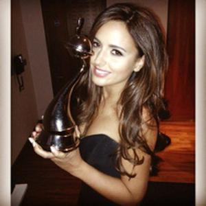 Nadia Forde poses with National Television Award for I'm a Celebrity Get Me Out of Here