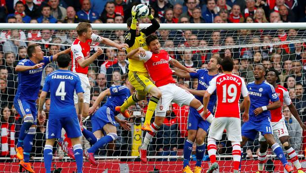 "Football - Arsenal v Chelsea - Barclays Premier League - Emirates Stadium - 26/4/15 Chelsea's Thibaut Courtois in action with Arsenal's Olivier Giroud Reuters / Eddie Keogh Livepic EDITORIAL USE ONLY. No use with unauthorized audio, video, data, fixture lists, club/league logos or ""live"" services. Online in-match use limited to 45 images, no video emulation. No use in betting, games or single club/league/player publications.  Please contact your account representative for further details."