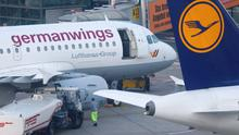 A Germanwings and Lufthansa aircraft are parked on the apron at Dusseldorf airport March 24, 2015. An Airbus operated by Lufthansa's Germanwings budget airline crashed in a remote snowy area of the French Alps on Tuesday, killing all 150 on board including 16 schoolchildren. Germanwings confirmed its flight 4U 9525 from Barcelona to Duesseldorf went down with 144 passengers and six crew on board.       REUTERS/Ina Fassbender