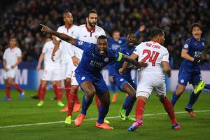 LEICESTER, ENGLAND - MARCH 14:  Wes Morgan of Leicester City celebrates after scoring the opening goal during the UEFA Champions League Round of 16, second leg match between Leicester City and Sevilla FC at The King Power Stadium on March 14, 2017 in Leicester, United Kingdom.  (Photo by Laurence Griffiths/Getty Images)
