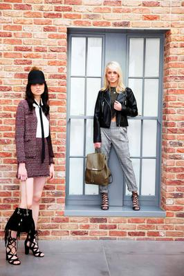 Pictured (l to r) Maria wears Knitted Jacket, €18; Knitted Skirt,€14; Cream Blouse, €13; Suede Bag, €16, Lace Up Sandal, €26 and Gracie wears Black Biker, €35; Khaki Backpack, €14, Check Trouser, €16, Lurex Top, €10l Snake Print Heels, €22. Photograph: Leon Farrell / Photocall Ireland
