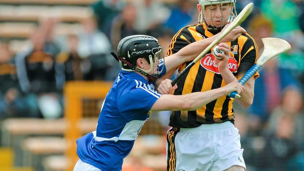 Kilkenny's Joey Cuddihy is put under pressure by Joe Geaney