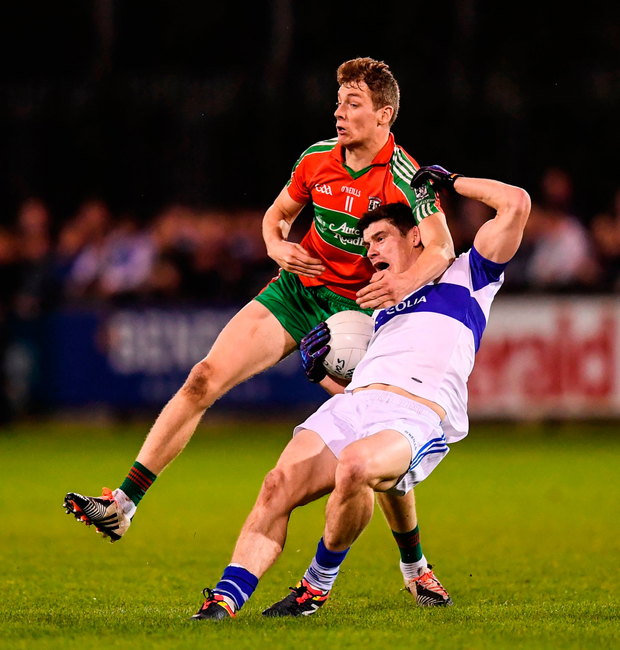 St Vincent's attacker Diarmuid Connolly (right) is fouled by Jason Whelan of Ballymun Kickhams, resulting in a red card during the Dublin SFC semi-final at Parnell Park last night. Photo by Stephen McCarthy/Sportsfile