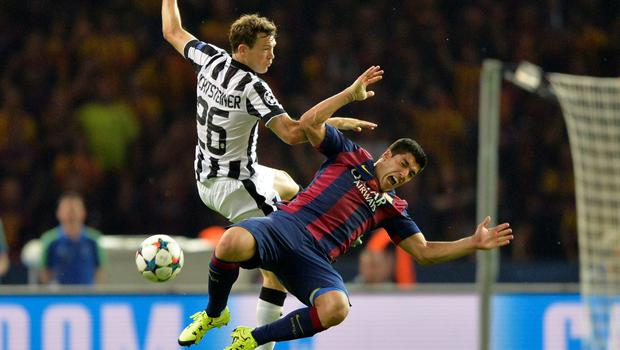 Barcelona's Luis Suarez goes down after a challenge with Stephan Lichtsteiner