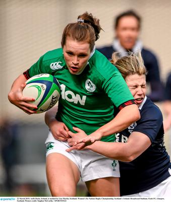 Aoife Doyle, Ireland, is tackled by Lisa Martin, Scotland. Women's Six Nations Rugby Championship, Scotland v Ireland. Broadwood Stadium, Clyde FC, Glasgow, Scotland. Picture credit: Stephen McCarthy / SPORTSFILE