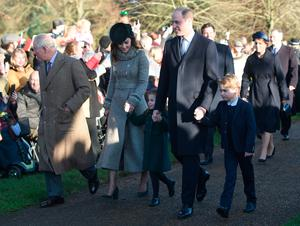 The Prince of Wales with the Duke and Duchess of Cambridge and their children Prince George and Princess Charlotte arriving to attend the Christmas Day morning church service at St Mary Magdalene Church in Sandringham, Norfolk.  Joe Giddens/PA Wire
