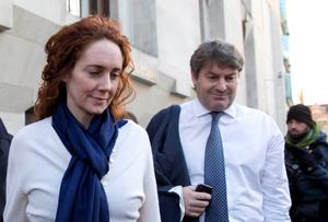 Former News International Chief Executive Rebekah Brooks and her husband Charlie leave the Old Bailey courthouse