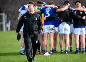 Cavan manager Mickey Graham leaves the field after talking with his players in Clones last week. Photo: Sportsfile