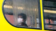 Extra protection: A passenger wears a protective face mask on a bus in Dublin. PHOTO: PA