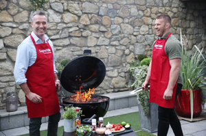 Kevin Dundon and Sean O'Brien throw some beef on the barbecue.