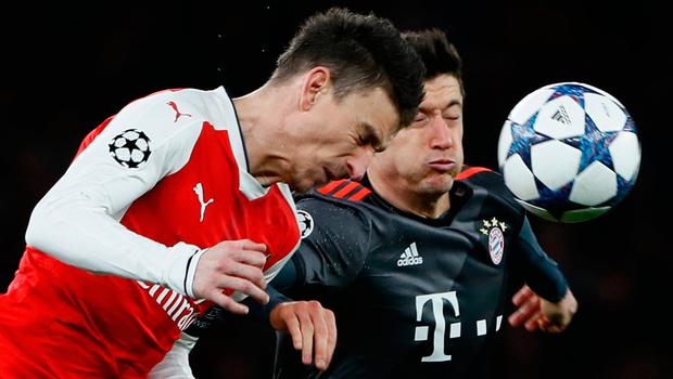 Arsenal's Laurent Koscielny in action with Bayern Munich's Robert Lewandowski. Photo   Stefan Wermuth/Reuters