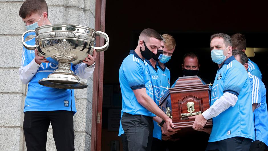 Dublin GAA fan Tony Broughan's coffin is carried from the church following his funeral   Picture; Gerry Mooney
