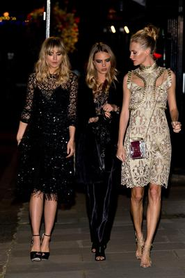 (L-R) Suki Waterhouse, Cara Delevingne and Poppy Delevingne attend the Downing Street reception hosted by Samantha Cameron during London Fashion Week