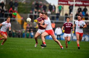 Cillian McDaid of Galway and Tyrone's Brian Kennedy come together in the middle of the park.  Photo: David Fitzgerald/Sportsfile