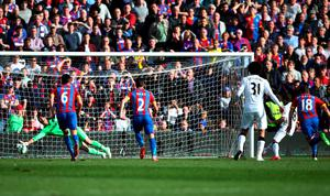 Juan Mata scores from the penalty spot past Julian Speroni of Crystal Palace