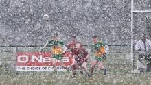 Spot the ball: Donegal and Down players battle through a snow storm during the Ulster U-20 Championship semi final at Loup, Co Derry. Photo: Margaret McLaughlin