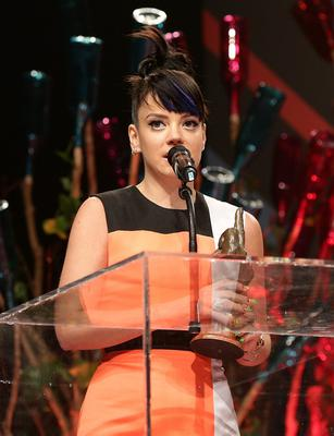 Lily Allen collects her award for Best Solo Artist during the 2014 NME Awards, at Brixton Academy, London. PRESS ASSOCIATION Photo. Picture date: Wednesday February 26, 2014. Photo credit should read: Yui Mok/PA Wire