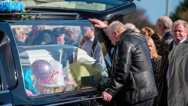 John O'Brien, grandfather of Holly and Jordan, mourns at their funeral in St Anne's Church, Shankill, Dublin Picture: Mark Condren