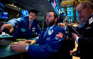 Traders work on the floor of the New York Stock Exchange. Reuters