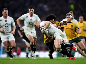 Mike Brown of England tries to escape the tackle of Henry Speight of Australia during the QBE international match between England and Australia at Twickenham