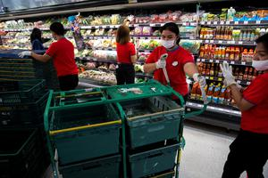 'Now that our streets have emptied, it's glaringly obvious who the real heroes of our society are: the friendly cashiers, the stockers and warehouse workers.' Photo: REUTERS