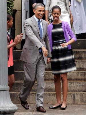 US President Barack Obama and his daughter Malia (14) outside St John's Church in Washington