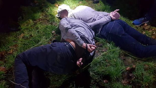 The burglary suspects handcuffed on the ground after their arrest in Co Louth last Thursday