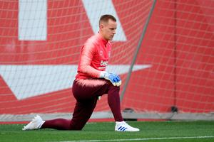 Marc-Andre Ter Stegen of Barcelona warms up during a training session