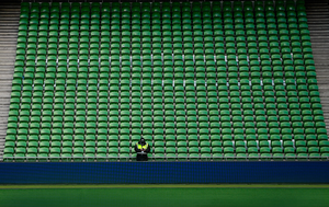 EMPTY: A security guard stands watch in front of a block of empty seating prior to the UEFA Nations League B match between Republic of Ireland and Finland at the Aviva Stadium last Sunday