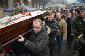 The coffin of a dead anti-government demonstrator is carried through Independence square in Kiev, Ukraine