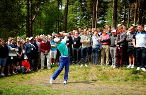 VIRGINIA WATER, ENGLAND - MAY 21:  Rory McIlroy of Northern Ireland hits from a path on the 11th hole during day 1 of the BMW PGA Championship at Wentworth on May 21, 2015 in Virginia Water, England.  (Photo by Richard Heathcote/Getty Images)