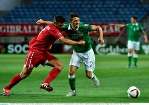 4 September 2015; Wes Hoolahan, Republic of Ireland, in action against Lee Casciaro, Gibraltar. UEFA EURO 2016 Championship Qualifier, Group D, Gibraltar v Republic of Ireland. Est?dio Algarve, Faro, Portugal. Picture credit: David Maher / SPORTSFILE