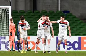 Dundalk's Sean Hoare celebrates after scoring their team's second goal with team-mates during the Europa League Group B defeat to Arsenal at the Aviva Stadium