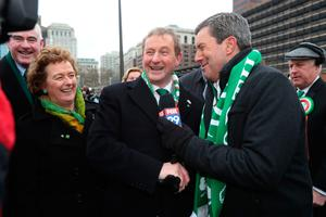 Taoiseach Enda Kenny (centre) is interviewed by Bob Kelly of FOX 29 News during the annual St Patrick's Day parade in Philadelphia, as part of his US visit. Photo: Niall Carson/PA Wire