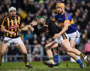 Kilkenny's Eoin Murphy, supported his full back, Pádraig Walsh, is tackled by Seamus Callanan of Tipperary. Photo: Ray McManus/Sportsfile